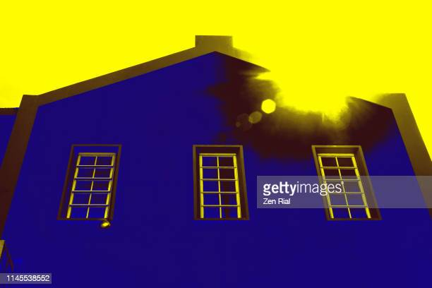 exterior wall and windows of a building with colors converted to blue and yellow - saturated colour stock pictures, royalty-free photos & images
