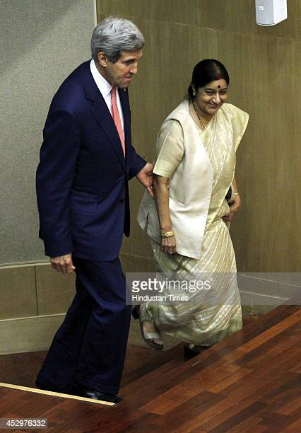 External Affairs Minister Sushma Swaraj and US Secretary of State John Kerry arrive to speak with media after their meeting on July 31 2014 in New...