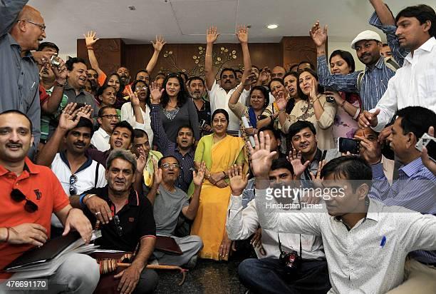 External Affairs Minister Sushma Swaraj pose along with the first batch of Kailash Mansarovar Yatris at Jawahar Lal bhawan Janpath on June 11 2015 in...
