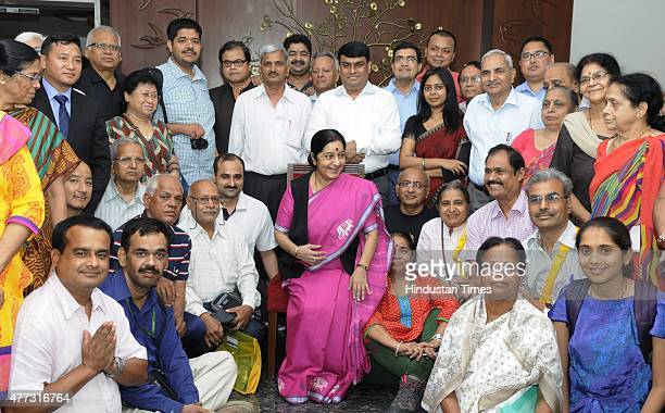 External Affairs Minister Sushma Swaraj poses with pilgrims for photographs during the flag off ceremony of the first batch of Kailash Mansarovar...