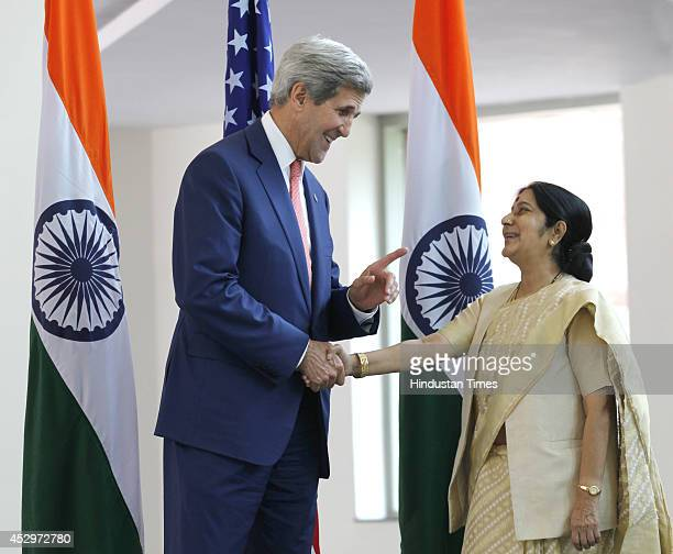 External Affairs Minister Sushma Swaraj shakes hand with US Secretary of State John Kerry before their meeting on July 31 2014 in New Delhi India The...