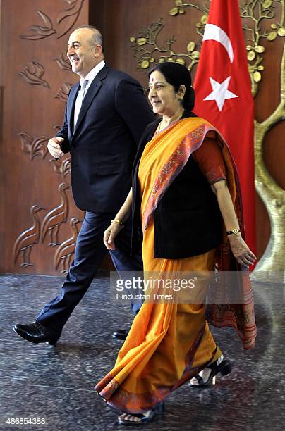 External Affairs Minister Sushma Swaraj with her Turkish Minister of Foreign Affairs Mevlut Cavusoglu on March 19 2015 in New Delhi India India...