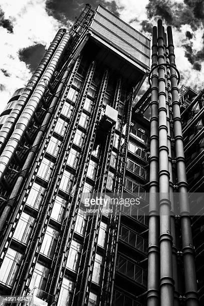 External lift shafts on the metallic Lloyd's of London building in the heart of London's financial district.