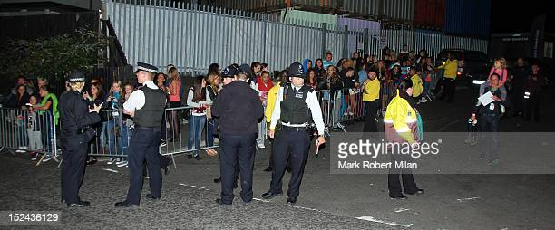 External view of fans and the police at the Roundhouse after the One Direction concert on September 20 2012 in London England