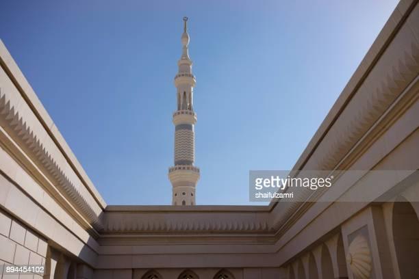 external view of minaret for nabawi mosque - shaifulzamri stock-fotos und bilder