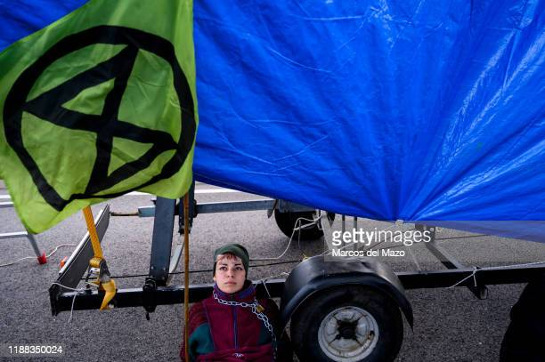 Extinction Rebellion activist chained to structure during a protest outside IFEMA where UN Climate Change Conference COP25 is being held Fridays for...