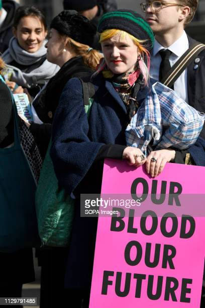 Extinction Rebellion activist seen holding a placard during the march Hundreds of activists from the Extinction Rebellion climate change movement...