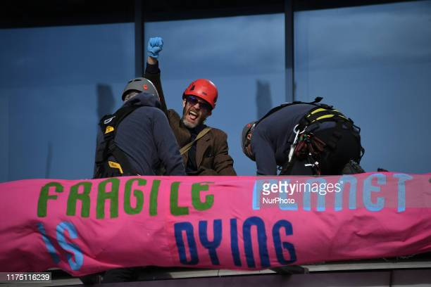 Extinction Rebellion activists are arrested by police as they occupy London City Airport on October 10, 2019 in London, England. Extinction Rebellion...