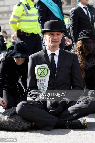 Extinction Rebellion activists are seen blocking the street Hundreds of activists from the Extinction Rebellion climate change movement gathered at...