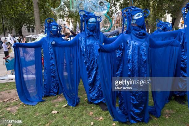 Extinction Rebellion activists Blue Rebels perform at the Marine Rebellion march on 6th September 2020 in London, United Kingdom. Ocean Rebellion,...