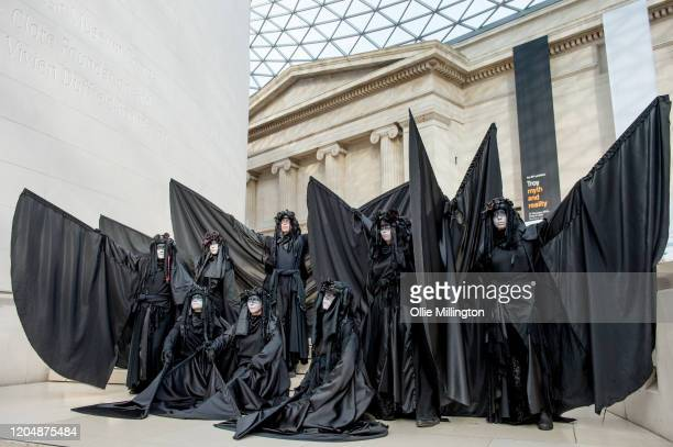 Extinction Rebellion Activists from theatric performance group 'The Red Brigade' wearing black for the first time ever to represent global oil spills...