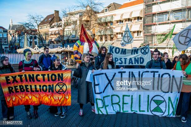 Extinction rebellion activists hold banners during the demonstration. For the second time, Extinction Rebellion activists have carried out a peaceful...