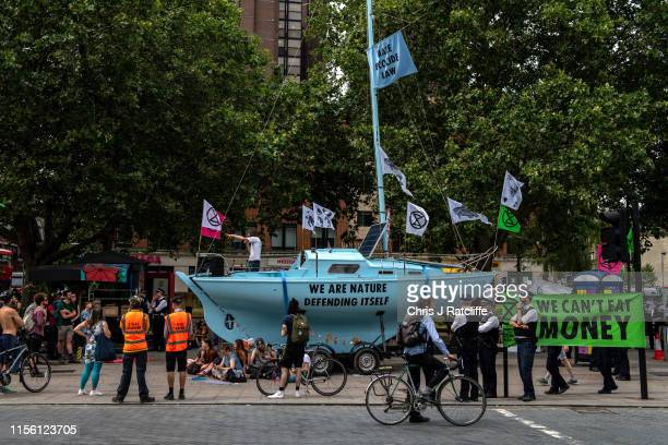 Extinction Rebellion activists hold discussions on the climate from a boat opposite their camp on Waterloo Millennium Green as they stage a week of...