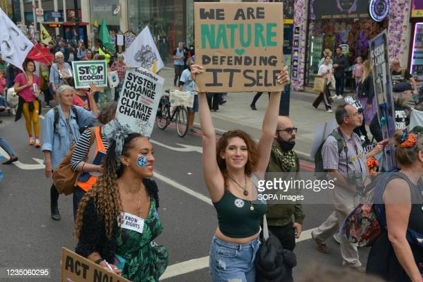 Extinction Rebellion activists hold placards during the demonstration. Extinction Rebellion Activists marched from Trafalgar Square to Marble Arch...