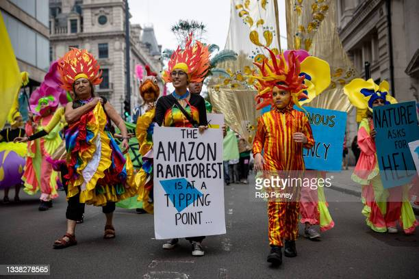 Extinction Rebellion activists in costume march from Trafalgar Square on September 04, 2021 in London, England. Over the past 2 weeks, climate action...