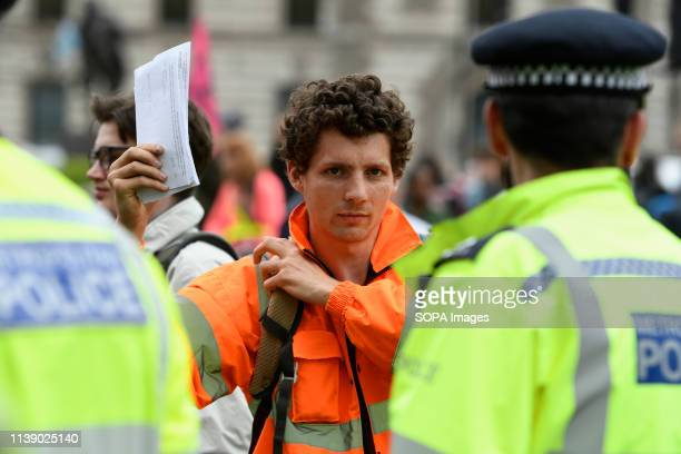 Extinction Rebellion activists is seen holding a letter for his MP during the Extinction Rebellion march in London Extinction Rebellion protesters...