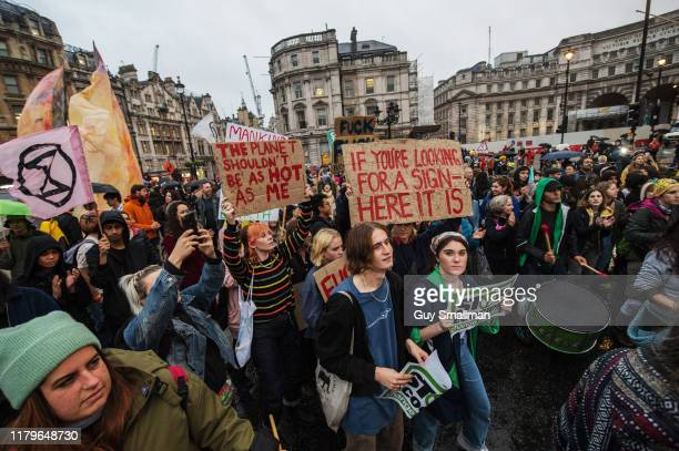 Extinction Rebellion activists occupy the road by Trafalgar square on October 7 2019 in London England Extinction Rebellion are planning to occupy...