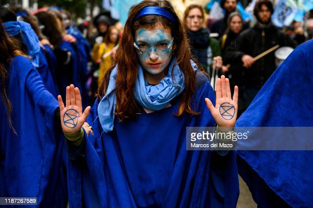 'Extinction Rebellion' activists performing the 'March of the Dead Oceans' a protest to condemn the loss of marine biodiversity coinciding with the...