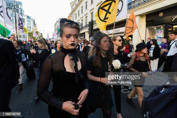 Extinction Rebellion activists stage a funeral march for the fashion industry along the Strand on the final day of London Fashion Week on 17...