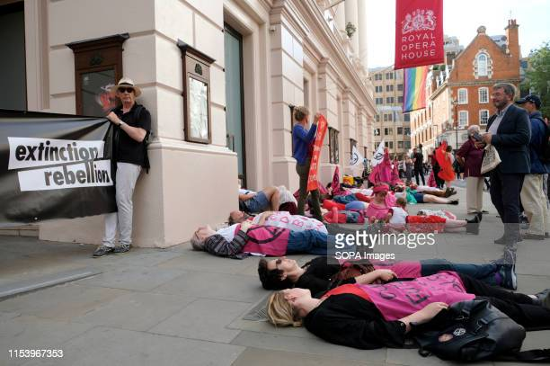 Extinction Rebellion activists staged a diein outside the Royal Opera House main entrance during a protest in London Environmental Activists from...