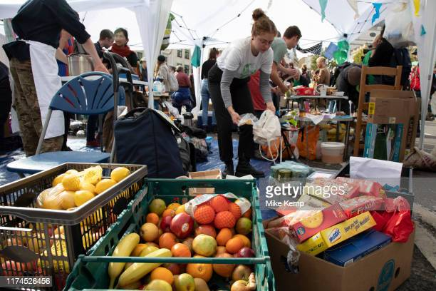 Extinction Rebellion climate change activists operate the food kitchen as sites around Westminster are blocked on 8th October 2019 in London England...