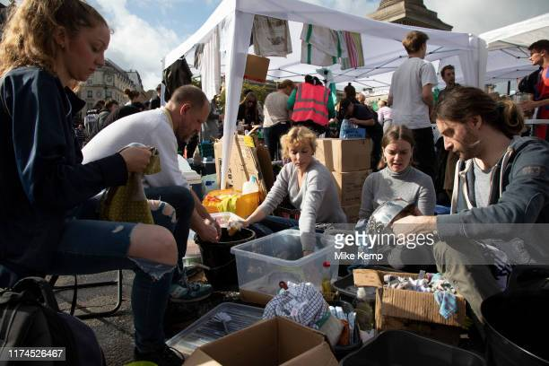 Extinction Rebellion climate change activists operate the food kitchen washing up as sites around Westminster are blocked on 8th October 2019 in...