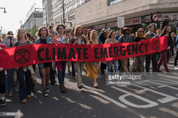 Extinction Rebellion climate change protest on 18th April 2019 in London United Kingdom Protesters occupy major London traffic arteries to call on...