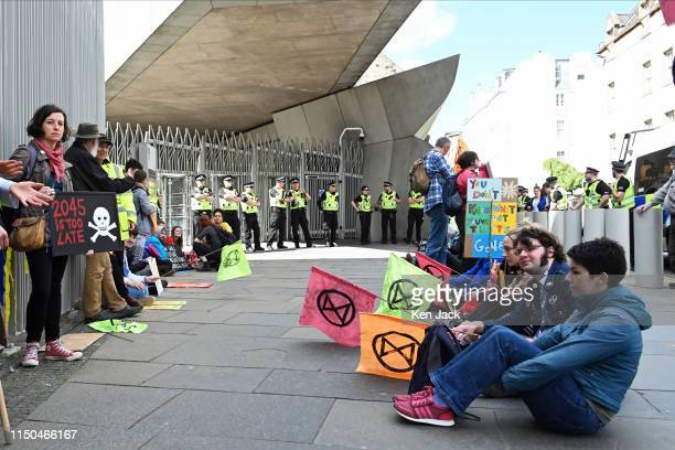 Extinction Rebellion climate change protestors outside the Scotish Parliament as MSPs on the Environment Climate Change and Land Reform Committee...