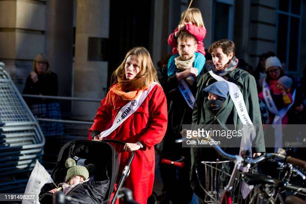 Extinction Rebellion Climate Crisis activist mothers with young children take part in a 'nursein' breast feeding protest outside The Conservative...