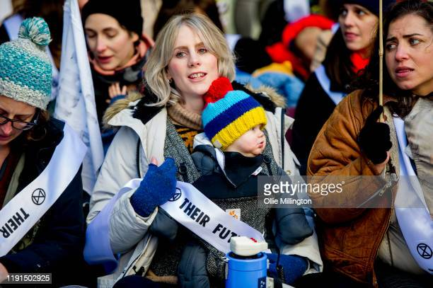 Extinction Rebellion Climate Crisis activist mothers with young children take part in a 'nursein' breast feeding protest outside The Labour Party...