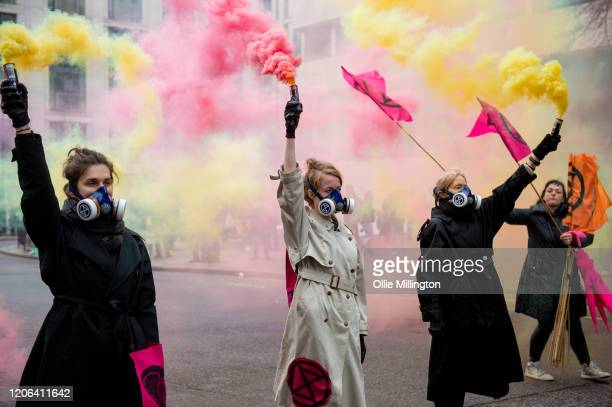 Extinction Rebellion Climate Crisis activists protesting outside of London Fashion Week blocking all roads into the event on February 15th 2020 in...