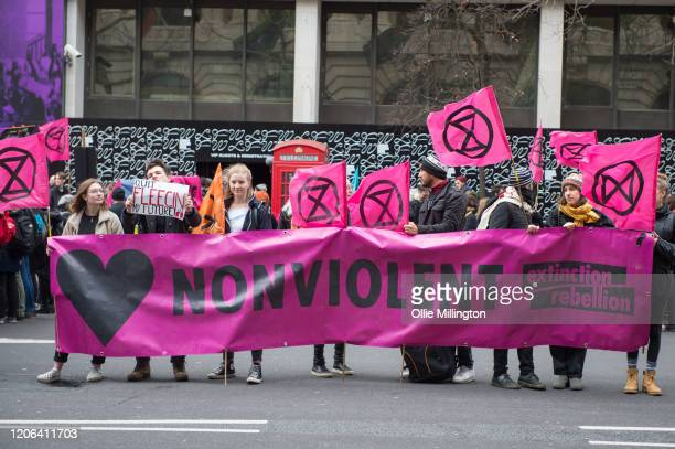 Extinction Rebellion Climate Crisis activists protesting outside of London Fashion Week blocking all roads into the event on February 15th, 2020 in...