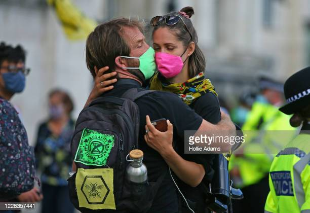 Extinction Rebellion demonstrators hug in Trafalgar Square on September 5, 2020 in London, England. The protest movement has organised a week of...