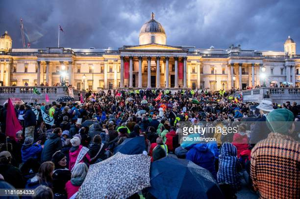 Extinction Rebellion environmental activists assemble at Trafalgar Square for speaches after a protests outside the offices of The Department of...