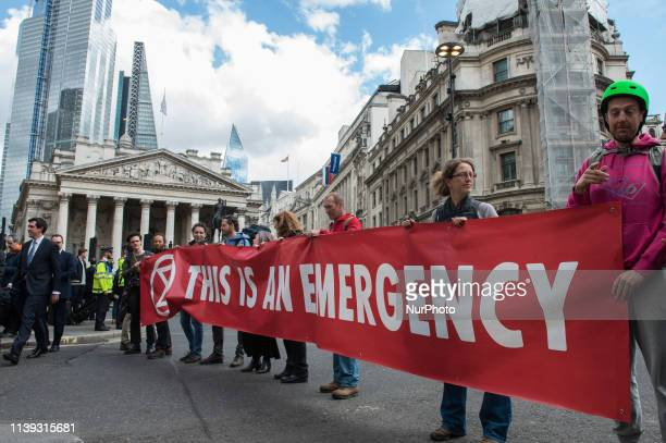 Extinction Rebellion environmental activists block traffic outside the Bank of England in the City of London on day eleven of protest action on 25...