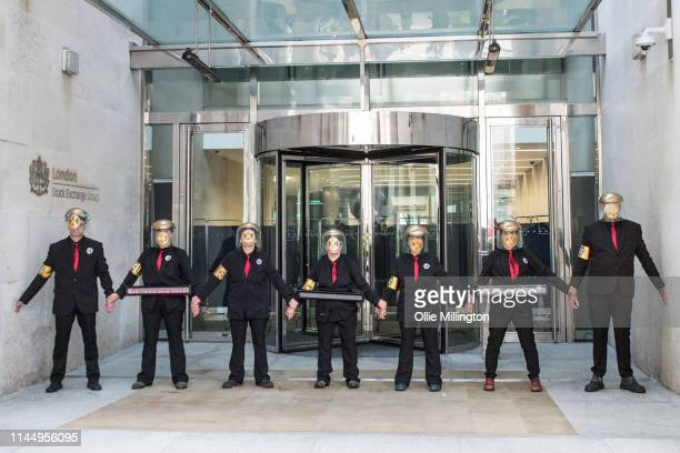 Extinction Rebellion environmental activists glue themselves to the main entrance of the London Stock Exchange on the group's final day of direct...