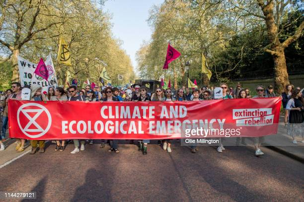 Extinction Rebellion environmental activists protest during a spontaneous funeral procession march from their site at Parliament Square past...