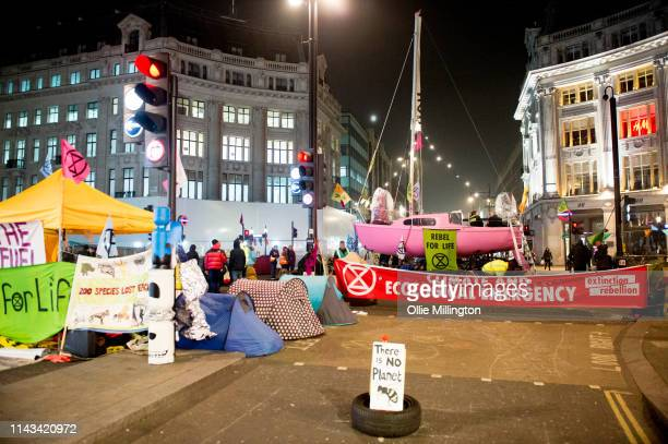 Extinction Rebellion environmental activists protest while occupying Oxford Circus one of 4 sites occupied since Monday on April 18 2019 in London...