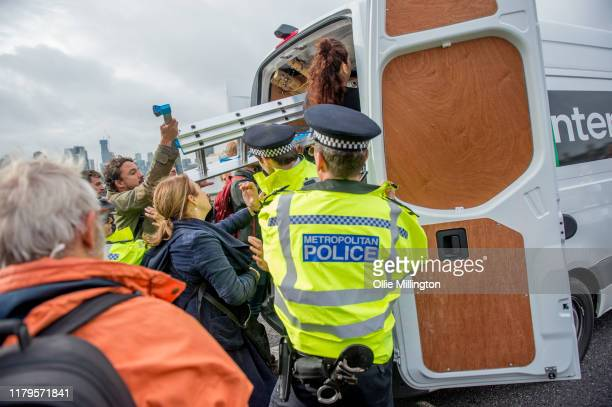 Extinction Rebellion environmental activists seen removing bamboo from a van in morning traffic to create an action site they are calling 'The...