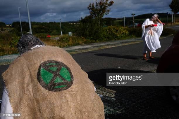 Extinction Rebellion Penitents getting ready to protest for climate change at Truro Cathedral in Cornwall at 11am on the 28th of August 2020 in...