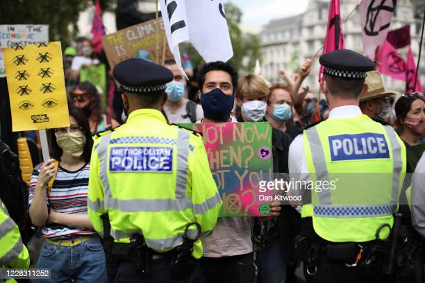 Extinction Rebellion protesters attend a climate change protest in Parliament Square on September 2, 2020 in London, England.
