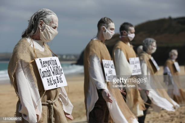 Extinction rebellion protesters on the beach in front of the Carbis Bay Hotel on April 03, 2021 in Carbis Bay, Cornwall. The protest called for an...