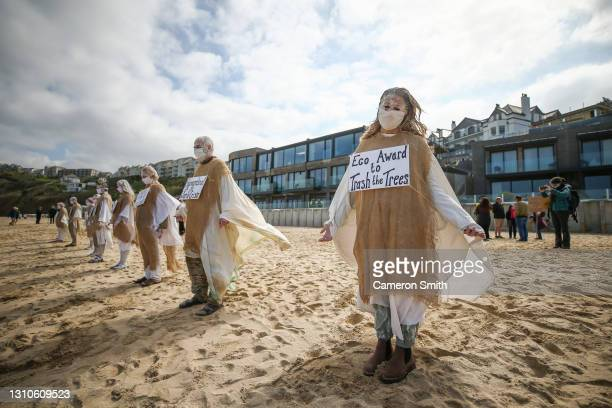 """Extinction rebellion protesters on the beach on April 03, 2021 in Carbis Bay, Cornwall, United Kingdom. The protest called for an end to """"ecocide""""..."""