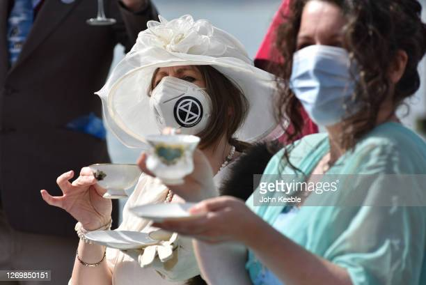Extinction Rebellion protesters stage a Titanic-themed dinner party in the sea to illustrate the threat of rising sea levels, on Chalkwell beach on...