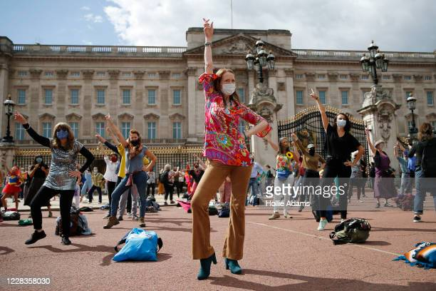 Extinction Rebellion protestors dance outside Buckingham Palace on September 5, 2020 in London, England. The protest movement has organised a week of...