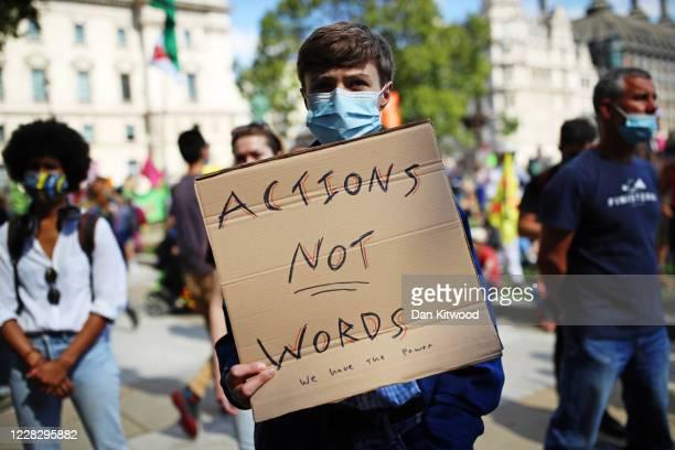 Extinction Rebellion protestors demonstrate at Westminster on September 1, 2020 in London, England. The environmental activist group organised...