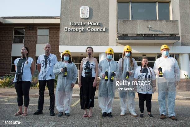 """Extinction Rebellion Southend protesters pose outside the Castle Point council offices after pouring fake oil down the throats of four """"victims"""" as a..."""