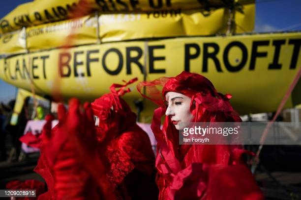 Extinction Rebellion's Red Rebel Brigade join demonstrators as they begin their second of a threeday mass action protest at the Bradley Open Cast...