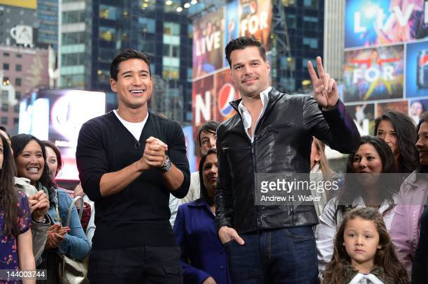 'Extra' host Mario Lopez interviews Ricky Martin at the Hard Rock Cafe New York on May 7 2012 in New York City