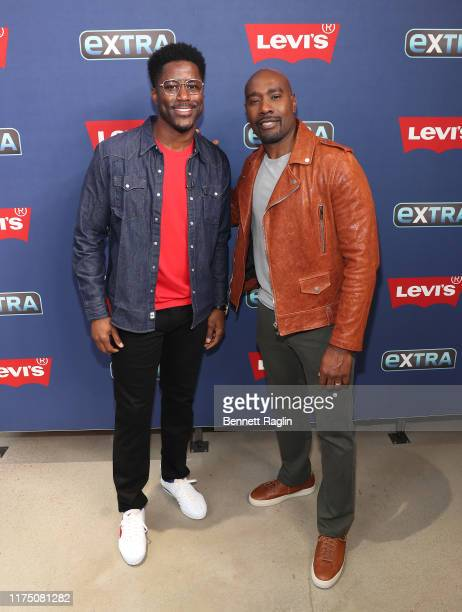 Extra host Nate Burleson and actor Morris Chestnut visit Extra at The Levi's Store Times Square on September 16 2019 in New York City